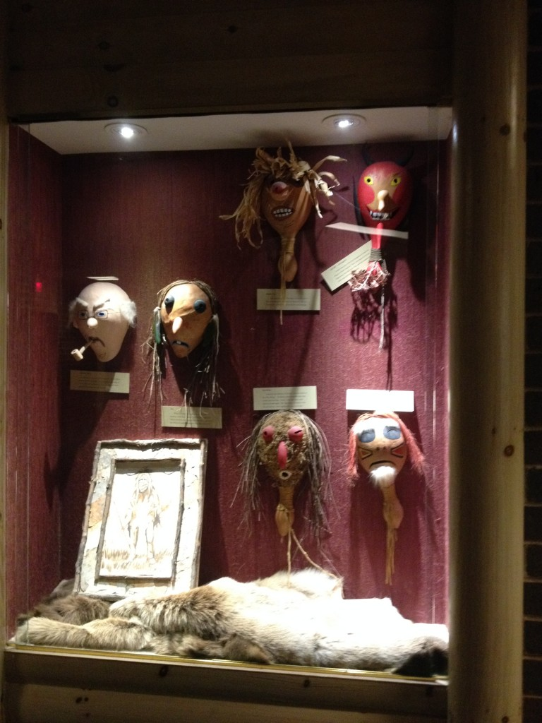 This is one of those displays of Native American art. The mask on the far left represents the first European they encountered, who just happened to be my great uncle Willie.